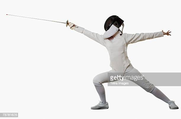 Studio shot of person in fencing outfit