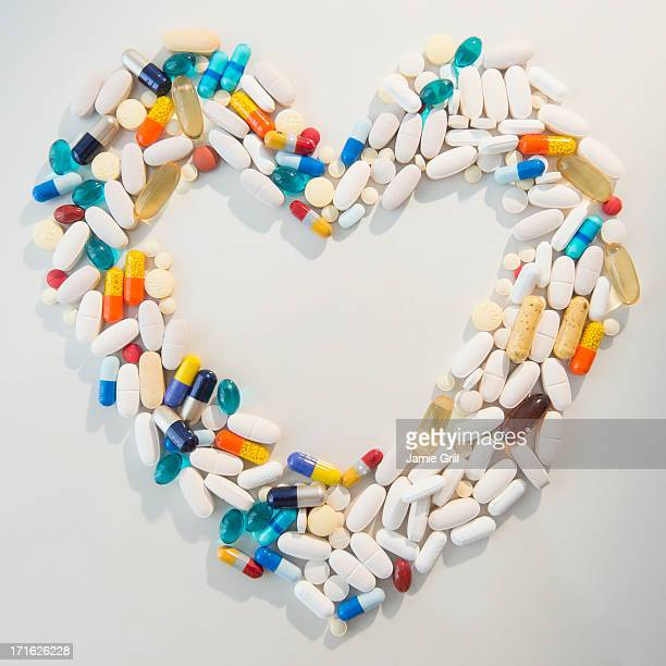 Studio shot of pills forming heart shape