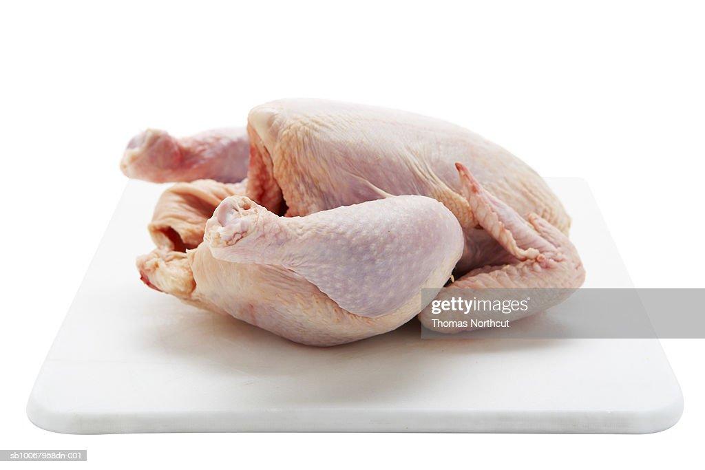 Studio shot of raw chicken : Stock Photo