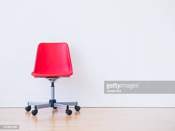Studio shot of red office chair