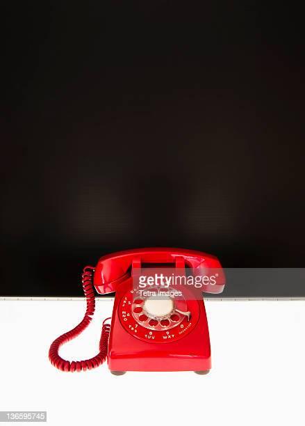 Studio shot of red phone