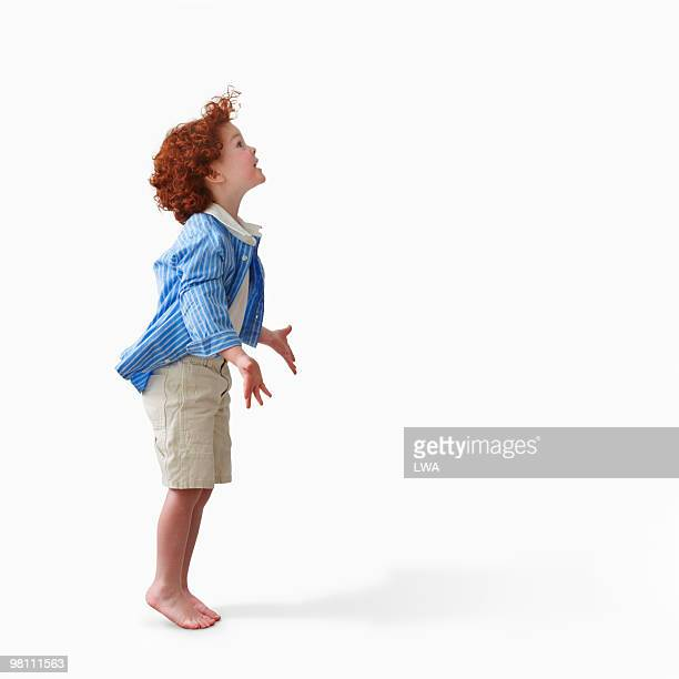 Studio Shot of Red-Headed Boy, Arms Outstretched