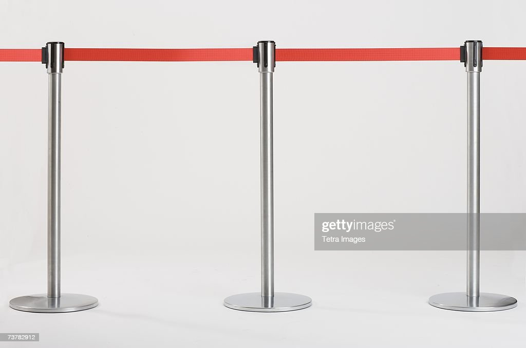 Studio shot of retractable belt crowd control barriers : Stock Photo