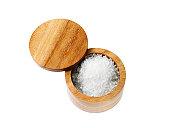 Studio shot of salt in wooden grinder