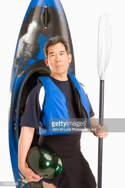 Studio shot of senior Asian man with kayak