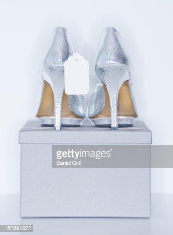 Studio shot of silver dress shoe on shoe box