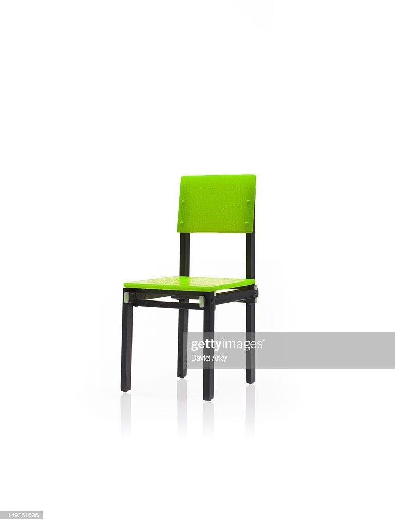 Studio shot of single green chair