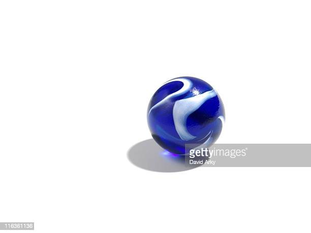 Studio shot of small blue glass ball