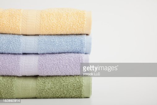 Studio shot of stack of pastel colored towels
