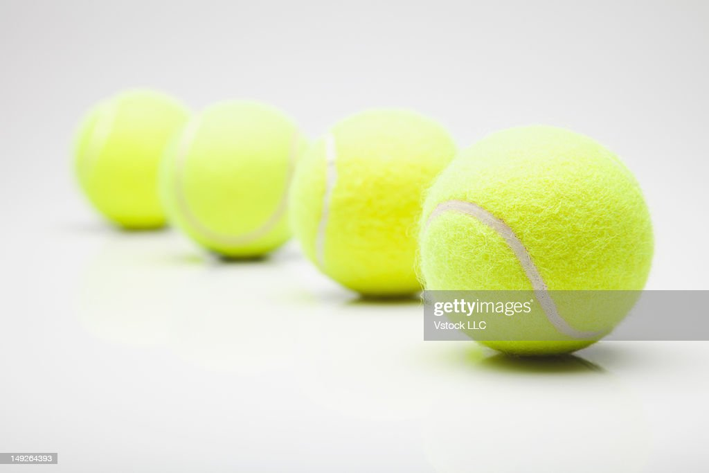 Studio shot of tennis balls in row : Stock Photo