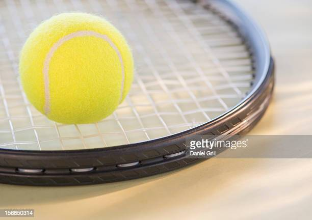 Studio Shot of tennis racket with ball