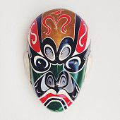 Studio Shot Of Tribal Mask Against White Background
