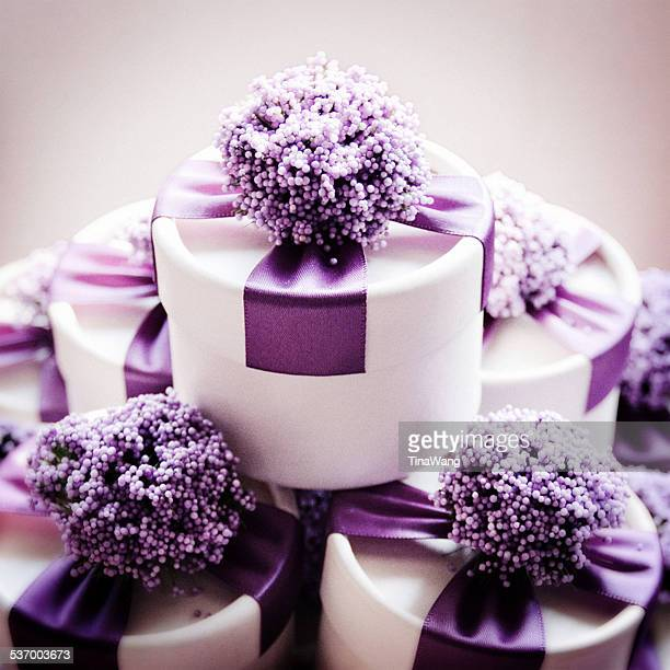 Studio shot of wedding candy boxes with purple ribbons