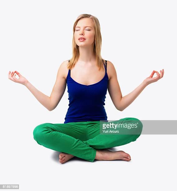 Studio shot of woman meditating