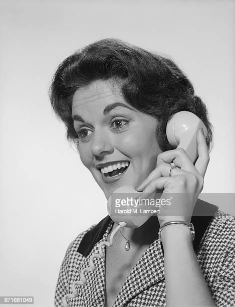 Studio Shot Of Woman Talking On Phone
