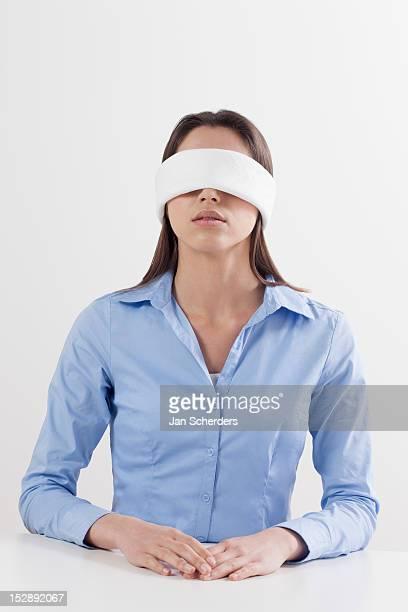 Studio shot of woman wearing blindfold