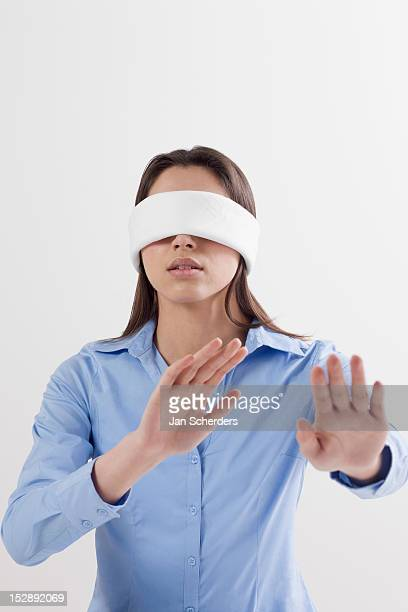 Studio shot of woman wearing blindfold