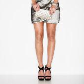 Studio shot of woman wearing mini dress and stilettos