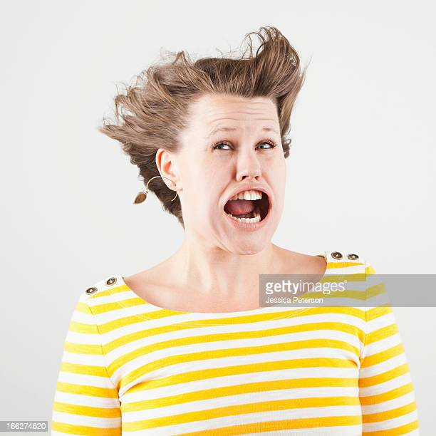 Studio shot of woman with windblown mouth