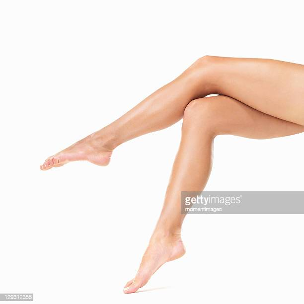 Studio shot of woman's barefoot legs