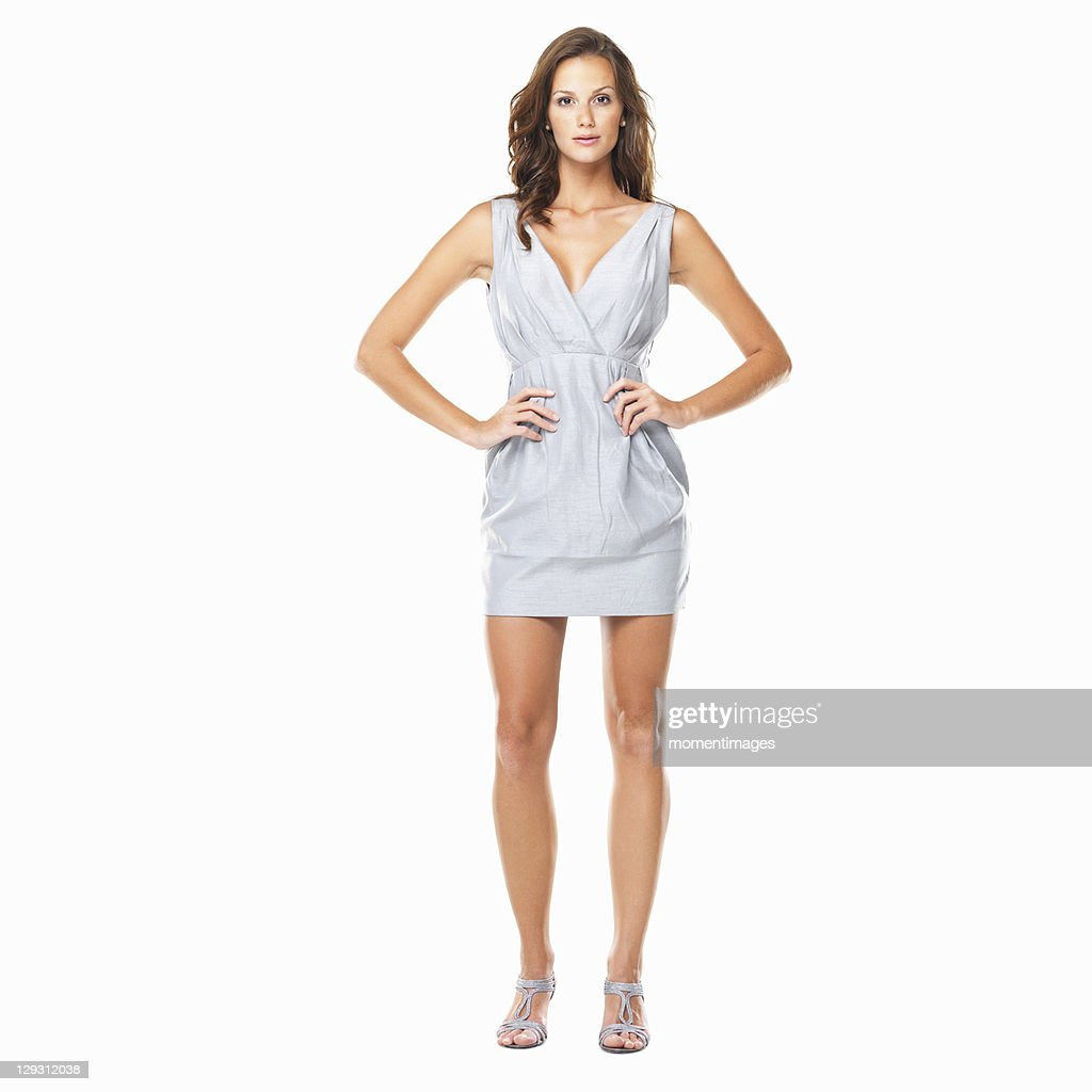 Studio shot of young attractive woman posing on white background