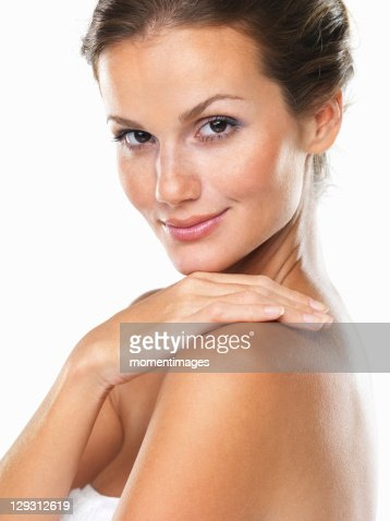 Studio shot of young attractive woman with hand on shoulder : Stock Photo