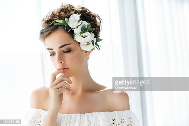 Studio shot of young beautiful bride on light background