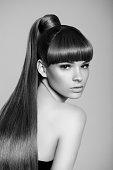 B&W studio shot of young beautiful woman