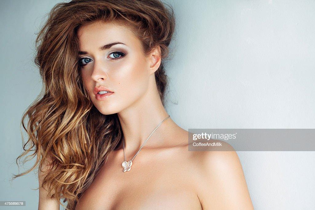 Studio shot of young beautiful woman : Stock Photo