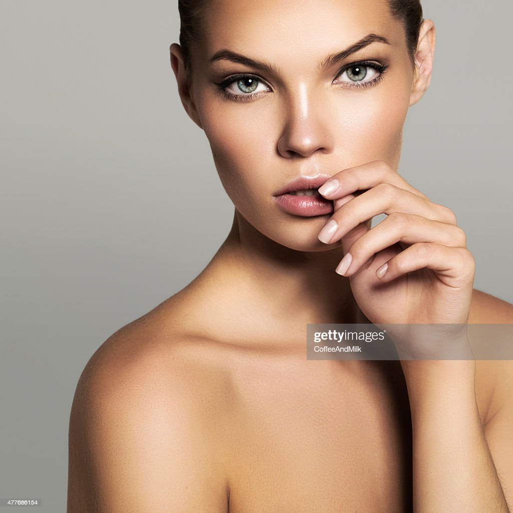 Studio shot of young beautiful woman : Stock Photo