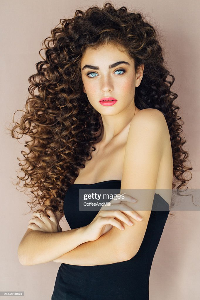Curly Hair Stock Photos and Pictures | Getty Images