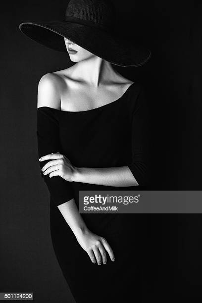 Studio shot of young beautiful woman wearing hat