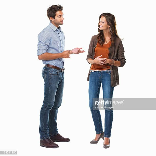 Studio shot of young couple having conversation