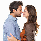 Studio shot of young couple rubbing noses