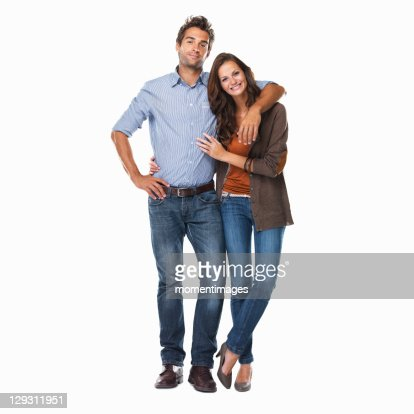 Studio shot of young couple standing together on white background