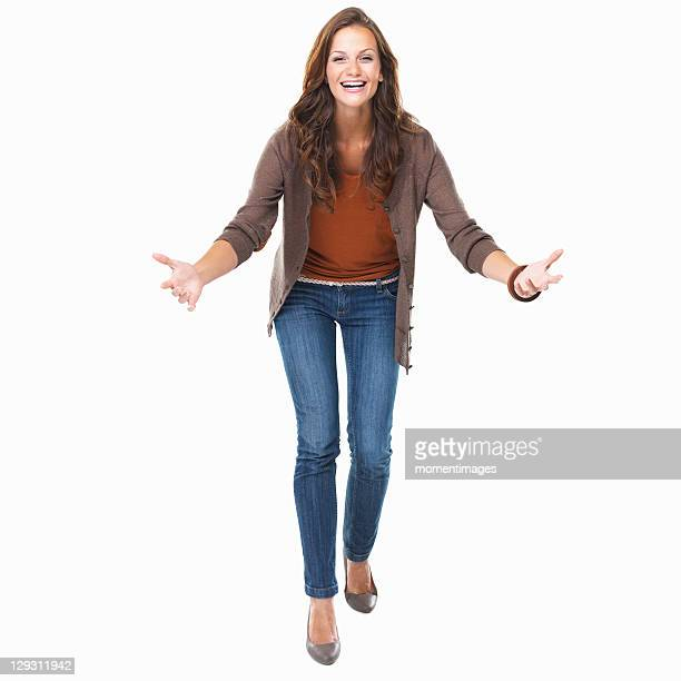 Studio shot of young enthusiastic woman smiling