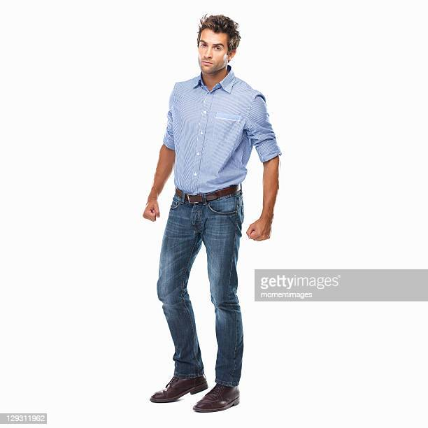 Studio shot of young man ready to fight standing on white background
