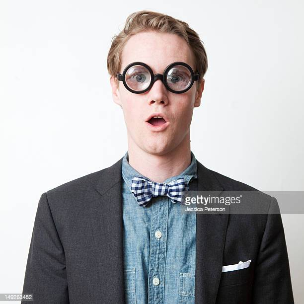 Studio shot of young man wearing funny glasses