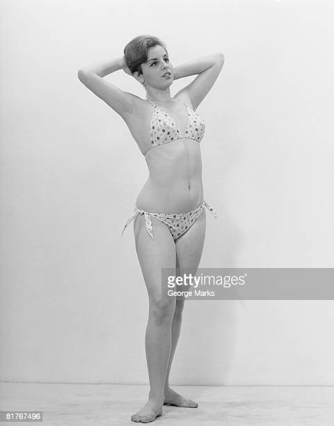 Studio shot of young woman in bikini