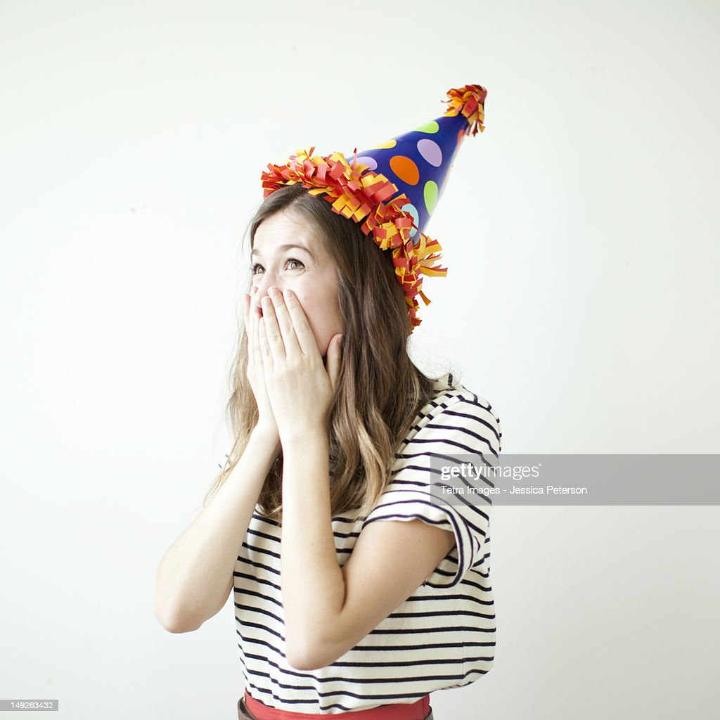 Studio shot of young woman wearing party hat