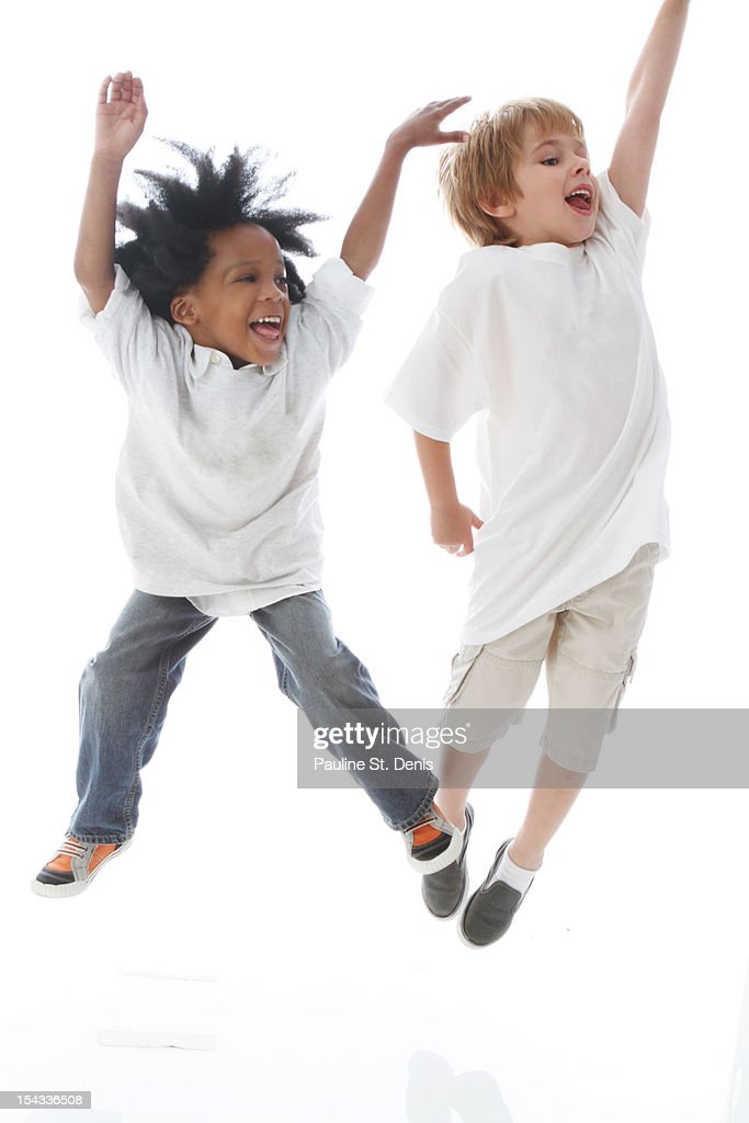 Studio shot portrait of boys (2-5, 6-7) jumping and laughing : Stock Photo