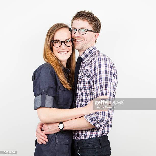 Studio Shot, portrait of young couple embracing