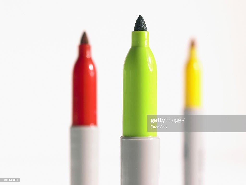 Studio shot red, green and yellow felt-tip pen