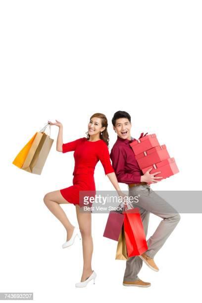 Studio shot Young couple shopping