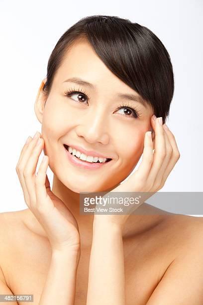 studio shot young woman doing facial