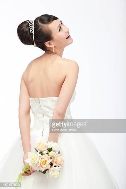 studio shot young woman in wedding dress