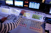 A studio sound engineer works during a radio show on September 19 2011 in the studios of the Europe 1 radio station in Paris AFP PHOTO FRED DUFOUR