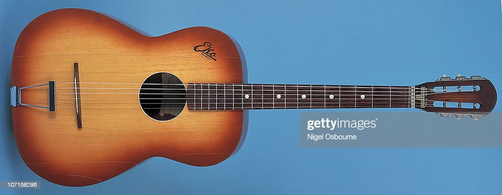Studio still life of a 1963 Eko P2 Angela acoustic guitar, photographed in the United Kingdom.