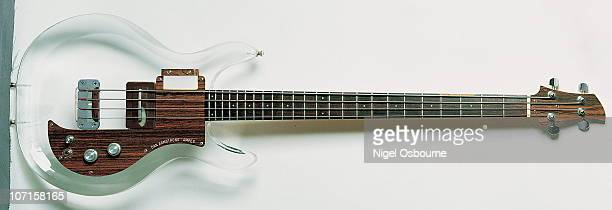 Studio still life of a 1970 Ampeg Dan Armstrong Bass guitar with a transparent perspex body photographed in the United Kingdom