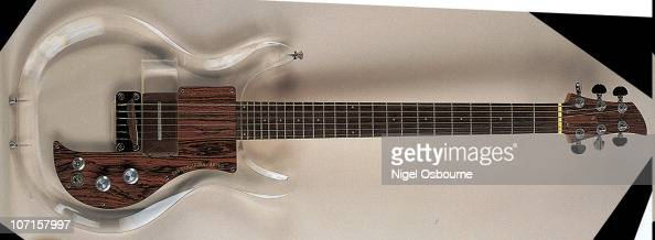 Studio still life of a 1970 Ampeg Dan Arnstrong guitar with a body made of transparent perspex photographed in the United Kingdom